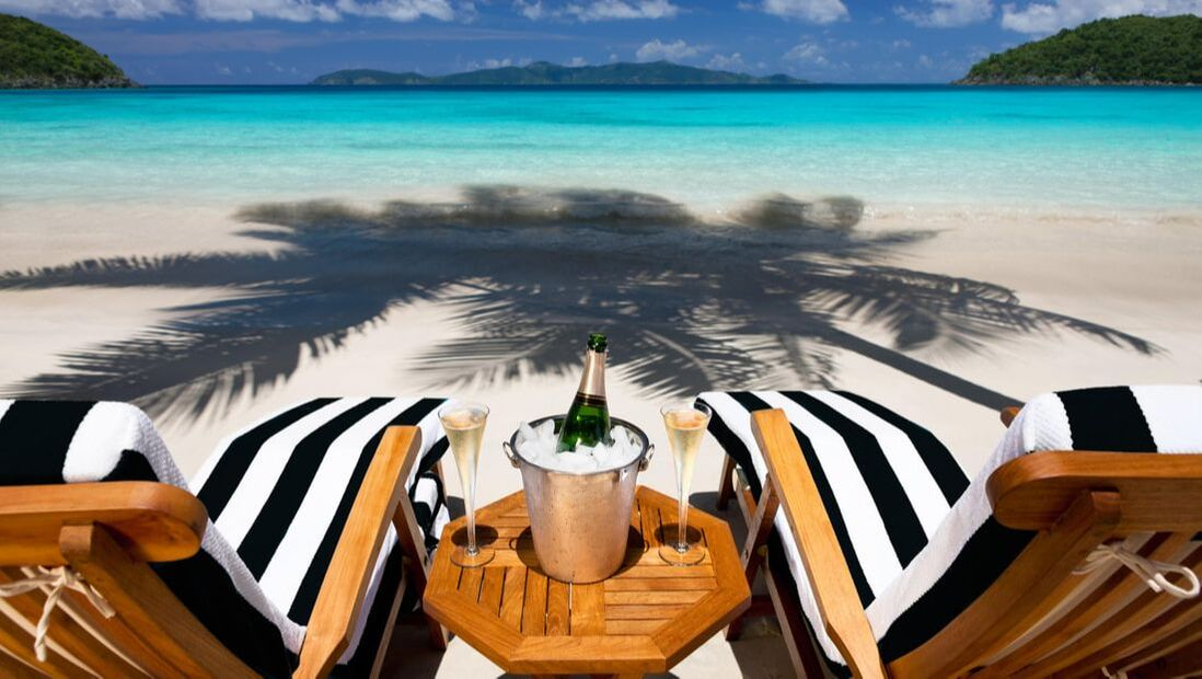 luxury beach chairs with champagne on a shoreline